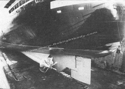 The underwater hull after coating with international paint's intersmooth HISOL.  You can also see the new propellors and Grim Wheels.