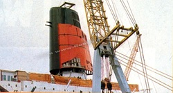 QE2's new, fatter funnel is fitted during the final stages of her conversion