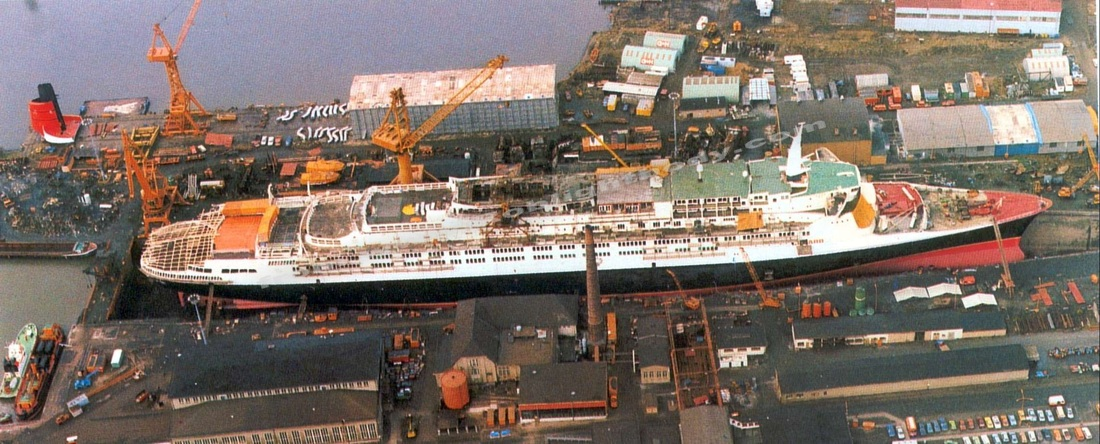QE2 goes topless during her