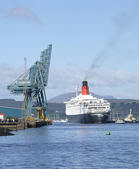 QE2 ties up at Greenock.  The cranes appear to salute the Queen.