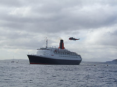 HMS Manchester escorted QE2 into Greenock and a Sea King helicopter, and press helicopters, hovered overhead.